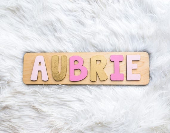 Name puzzle pink and gold nursery first birthday gift for like this item negle Choice Image