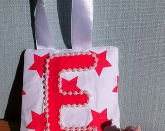 RED star tooth fairy pouch door-hanger with RED felt letter, PEARL beaded border, and red diagonal pocket on reverse for tooth/coin.