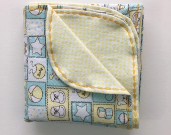 Pale Yellow and Blue Receiving Blanket with Baby Toy Designs. Ready to Ship!