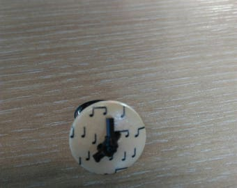 Ring button with black plastic buckles