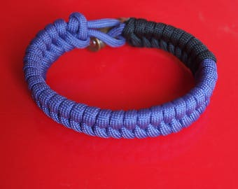 Paracord bracelet with black and purple shells