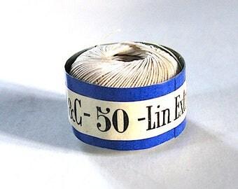 pretty white linen thread spool.