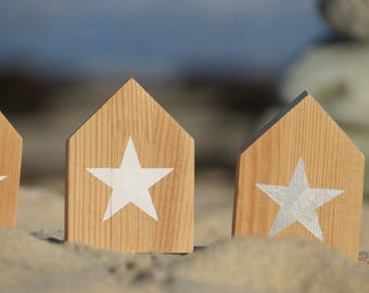 Small wooden ask beach hut