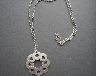 Brushed metal vintage abstract flower pendant on chain