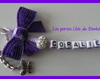 key 1 Purple and white name with bow