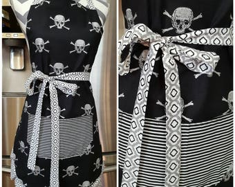 Adult Apron, Woman's apron. Black with silver and glitter cross bone skulls. Black and white striped pocket. Black and gray ties and frills.