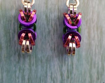 Green, pink, purple and silver. You get it all with these unusual earrings