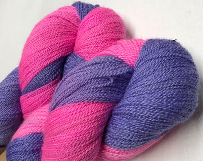 100g Extra fine merino / silk lace weight yarn, 80/20% 600 metres, hand dyed in scotland, bright purple and pink variegated
