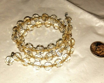 Wire memory wrap bracelet, made with smokey crystals....with one drop crystal