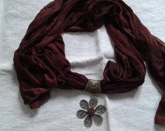 Brown scarf and flower bronze