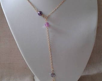 "necklace ""pretty shell and purple beads"""