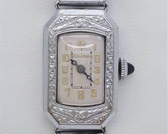 A vintage Bulova ladies watch, incised decorative case, art deco gild Arabic white dial