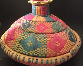 Lidded Weaved Basket In Green Pink And Brown.
