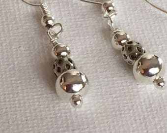 Silver dangle earrings. Silver earrings. Silver BoHo earrings. Silver drop earrings. On a silver ear wire.