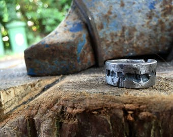 Hand forged erosion effect iron ring