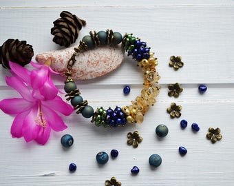 Gold forest. Pearl and bead bracelet