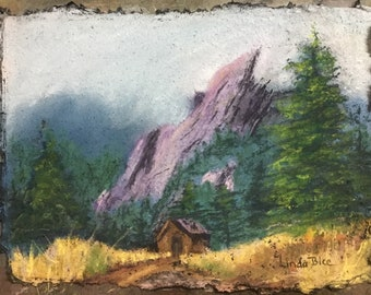Pastel Painting of the Boulder Flatirons in fog above Chataugua