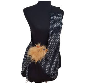 Dog sling, pet sling, reversible dog sling, adjustable pet sling, black dog sling, arrow print dog sling, dog carrier, sling pet carrier