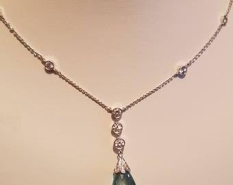A Vintage Aquamarine, and Diamond pendant in 18k gold.