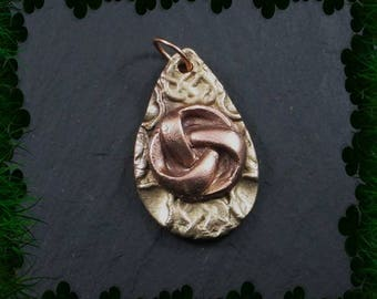 Copper celtic knot on bronze pendant