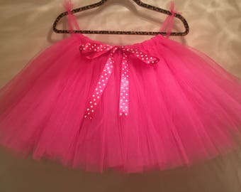 Minnie mouse inspired hot pink tutu with polkadot ribbon. Uk based Handmade tulle skirts perfect for flower girl weddings party's birthdays