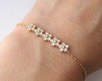 Bracelet set gold plated CZ flowers 750/000 18 k