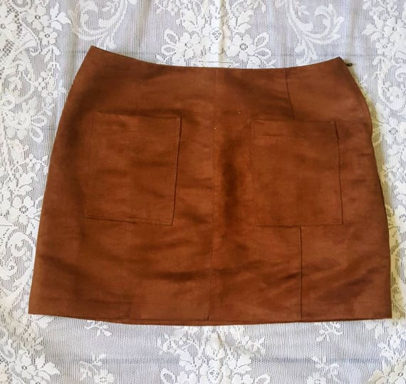 Faux Suede patch pocket skirt size 6. Rust colored 70s style mini skirt