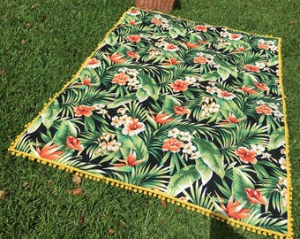 Palm leaves and bright flower with yellow pom pom trim picnic / beach blanket