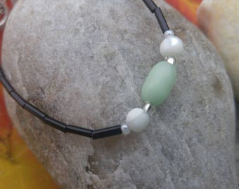 Bracelet green glass, white shell, black glass bugle beads,  glass seed beads, original design. Purchase benefits rescue animals.