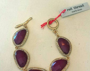 Ruby Red Rhinestone Gold tone Bracelet. A