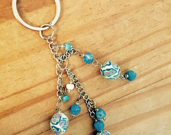 3 chain dangling blue keychain.