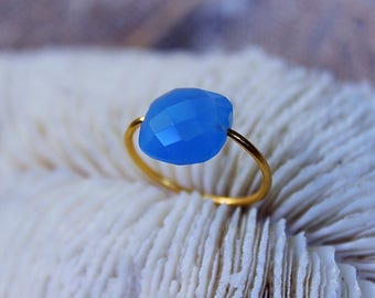 Yellow gold plated ring with a Blue chalcedony stone