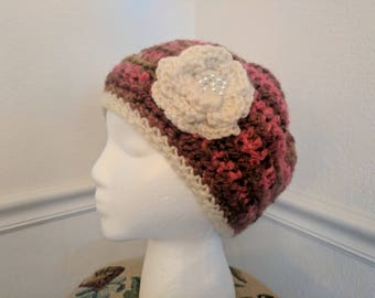 Fancy, multi-colored, hand-crocheted beanie with flower and pearl detailing.