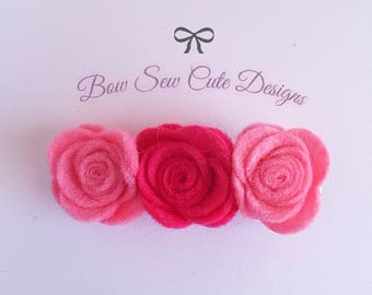 Pink flower rose trio set upon alligator clip
