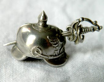 Detailed miniature Prussian pickelhaube (German WW1 period spiked helmet) charm.