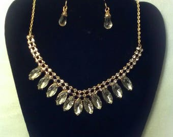This one of a kind set includes a necklace and earrings