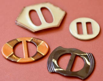 Four Celluloid Slide Buckles
