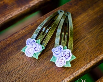 Two hairpins with small roses
