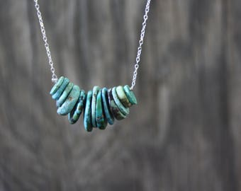 Beaded turquoise necklace on silver chain
