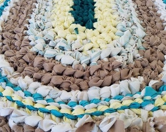 Handmade crocheted rag rug, green yellow brown turquoise, 33inx19in oval