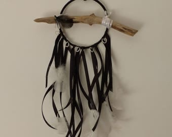 Small dream catcher black and white with feathers and Pearl hearts and a driftwood.