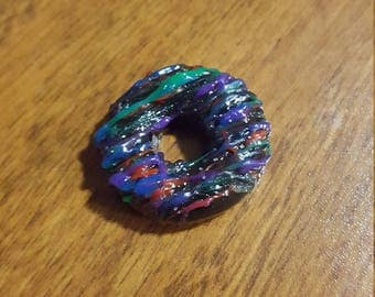 Black donut with colorful frosting