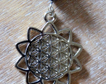 Lapis lazuli beads and flower of life pendant