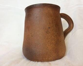 Dark amber wood fired wheel thrown coffee mug