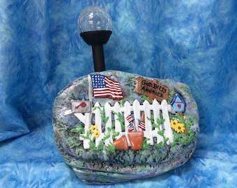 Solar ceramic rock with flag