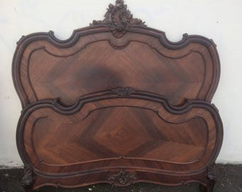 Antique French carved wooden bed