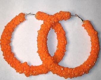 Orange crystal hoop earrings