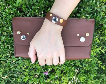 Clutch and hand strap for women.