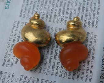 jewelry designer, Christian Dior earrings designed by Robert Goossens for the DUNE perfume 1987.enorme shell orange & gold