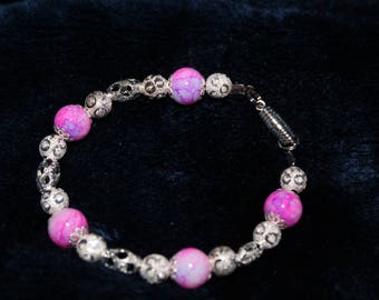 Pink glass bead and silver bracelet